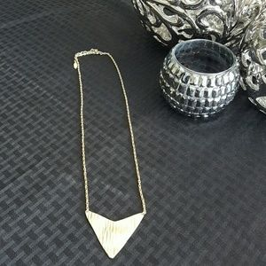 Gold tone necklace